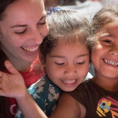 Happy children with their teacher at one of Projects Abroad's volunteer teaching placements in Costa Rica
